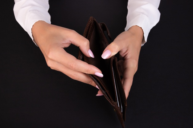 business-womans-hand-holds-empty-wallet-black-background_297535-511